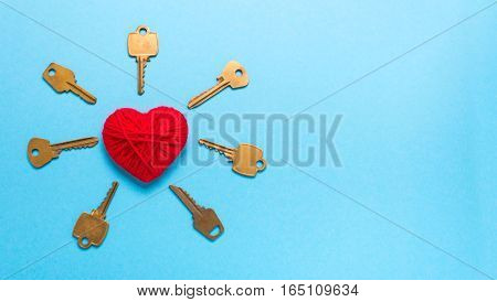 Golden Keys to a red heart on a blue background. Love Valentine's Day