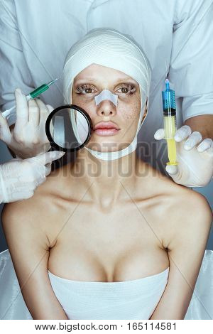 Woman's face and many hands with syringes near her face. Injections of skin rejuvenation. Cosmetic procedures
