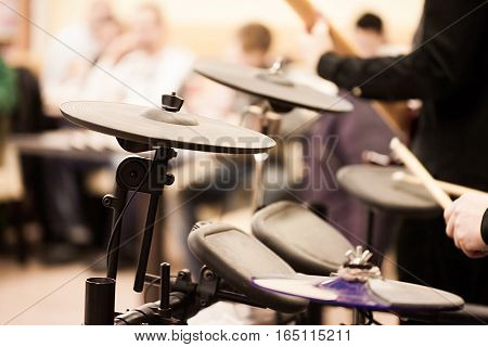 Man's Hands playing electronic drums. Perfomance, concert
