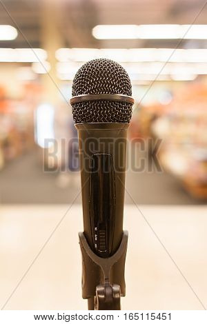 Microphone on stage, blurred background. Close up