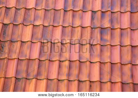 old clay tiles of red color on the roof