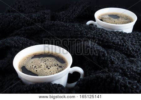 Cups Of Coffee On A Background Of Black Wool Scarf