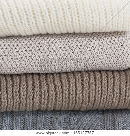 Pile of wool sweaters. Knit texture, warm