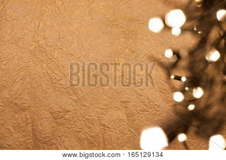 Christmas golden background with lights. Place for text