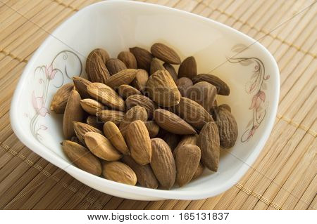plate of almonds on a bamboo napkin.
