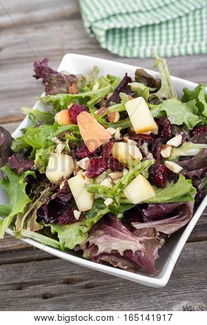 cranberry and aple fresh salad mix with almonds nuts