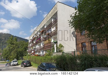 ZAKOPANE POLAND - SEPTEMBER 14 2016: Multi-family residential building with lots of balconies on the front facade was built on a side street in the city center