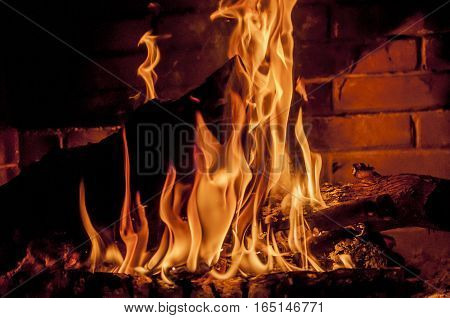 log is burning in fireplace, warm, heat