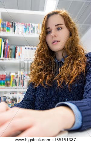 Beautiful Intelligent University Girl Using Laptop In White Modern Library
