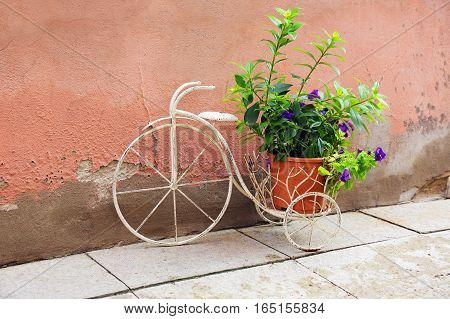 stand under a flower pot in the form of a bike