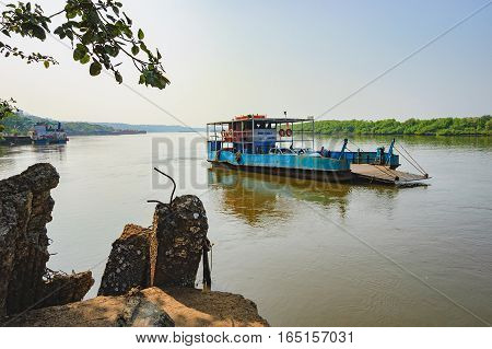 Goa, India - November 13, 2012: Ferry arriving to Chorao island, Salim Ali Bird Sanctuary, Goa, India. Ferries is the only means of transport across the many rivers of India, as there is no bridge.