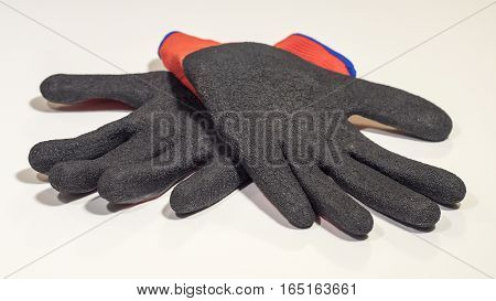 A pair of cotton work gloves isolated on white background
