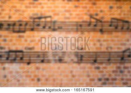 Blurred musical notes on brick background stock photo