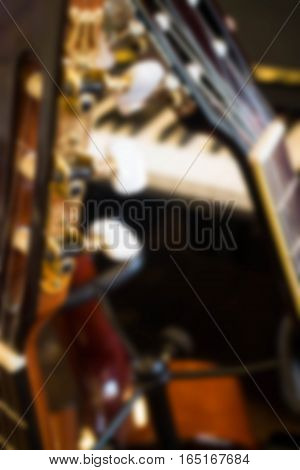 Blurred guitar in the music room, stock photo
