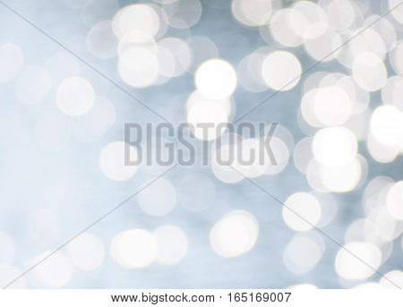 Silver grey blurred background with circle bokeh