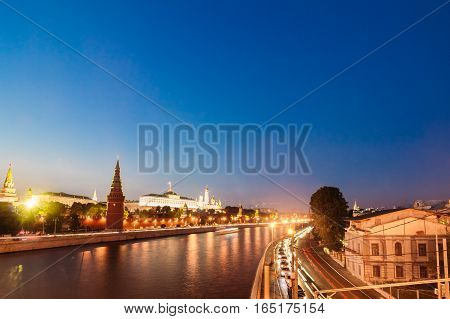 Cityscape Moscow with the river and the view of the Grand Kremlin Palace and the Dome of the church. Evening time