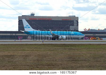 MOSCOW, RUSSIA - APRIL 15, 2015: Landing Boeing 737-800 (PH-BGA) KLM Royal Dutch Airlines on the background of terminal F of Sheremetyevo airport on a cloudy day