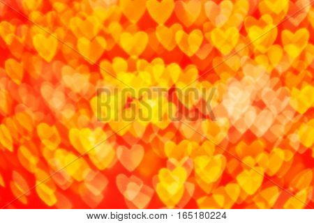 bokeh of heart blur background red and yellow tone