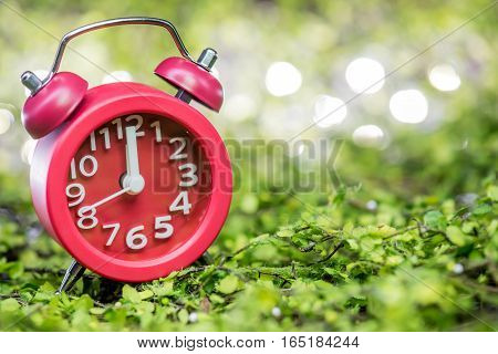Red clock at midnight time, waking for party