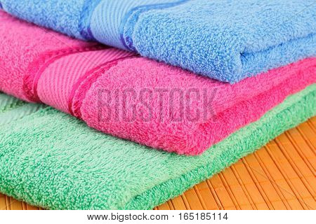 Colorful folded towels horizontal close up picture.