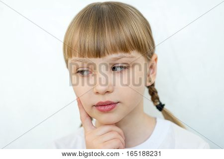 Portrait of young teenager girl emotional posing on white background isolated. think, question