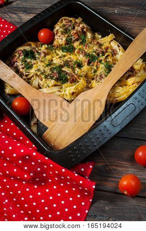 Baked rolled pasta with forcemeat and cheesy tomato sauce.