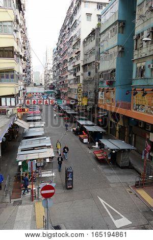 HONG KONG - NOVEMBER 26 2016: In The Streets of Hong Kong.Hong Kong became a colony of the British Empire after the First Opium War.