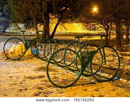 evening cityscape Parking lot of bikes winter