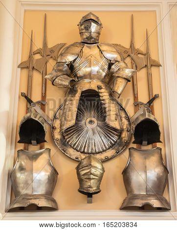 Armour of the medieval knight - helmet, armor, shield, halberd