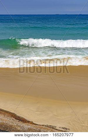 Green small and transparent wave on Devil beach in Ipanema Rio de Janeiro