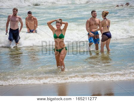BELMAR NEW JERSEY-AUGUST 1- Sunbathers enjoy the surf as a heat wave made for a perfect beach day on August 1 2015 in Belmar New Jersey.
