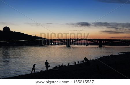 The bridge on the river during a sunset