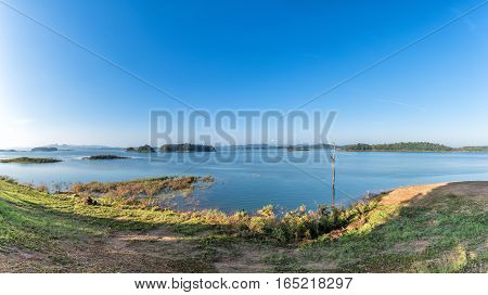Panorama of lake and clear blue sky in summer.