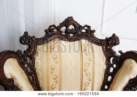 luxurious vintage armchair on the background wall.