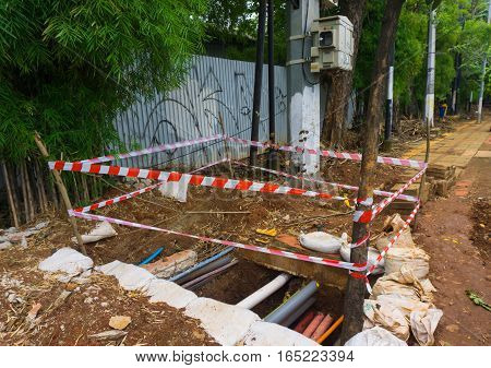 warning line surrounding a hole photo taken in Jakarta Indonesia java