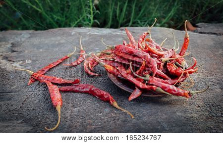 Dried red peppers on a wooden brown, dried chilli.