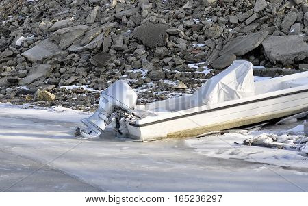 Wooden boat on the river during the winter thaw