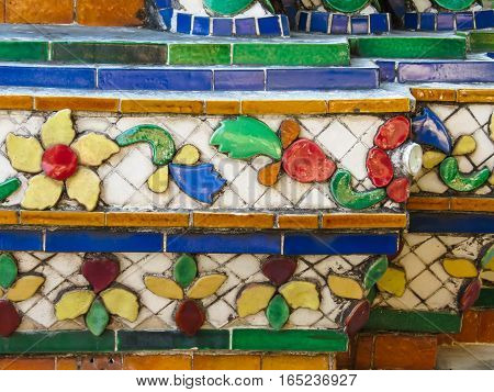 Close-up view of mosaic in the ancient Wat Arun Temple or The Temple of Dawn. Bangkok, Thailand