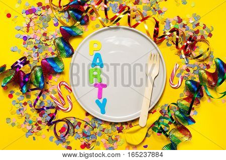 Party or Carnival background or Party concept with fun articles and party accessories empty plate above. Top view.