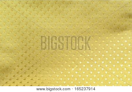 Gold foil paper with stars decor texture background for artwork.