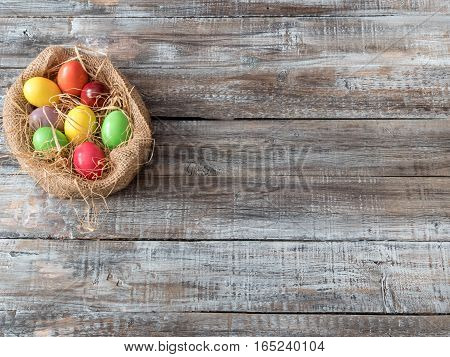 Easter Composition with chicken Eggs on the Warm Wooden Background