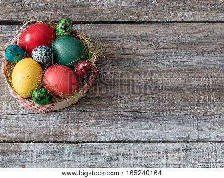 Easter Composition with chicken and quail eggs on the Wooden Background.