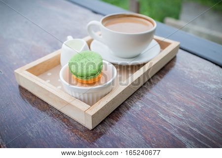 hot coffee breakfast set with fresh macaroon in outdoor bakery house cafe