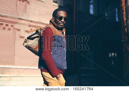 Fashion Portrait Stylish African Man Wearing Bag In Evening City