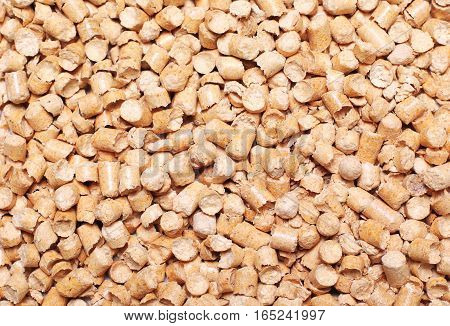 Many wooden pellets texture background top view