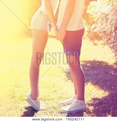 Summer happy young couple in love kissing outdoors colorful sunny photo bright warm colors
