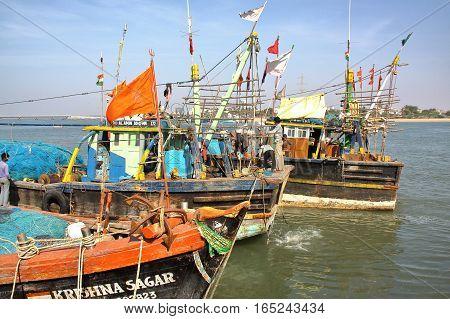 DIU, INDIA - JANUARY 9, 2014: Colorful fishing boats in a fishing port in Diu Island