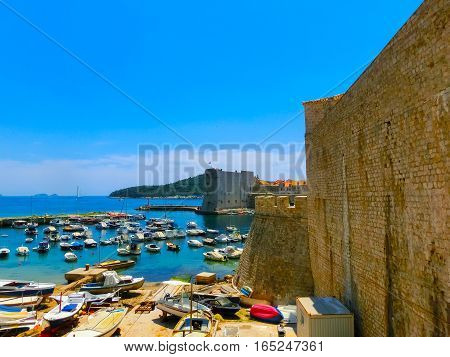 View through the fortress and marina in the old town of Dubrovnik, Croatia. Dubrovnik is a UNESCO World Heritage site