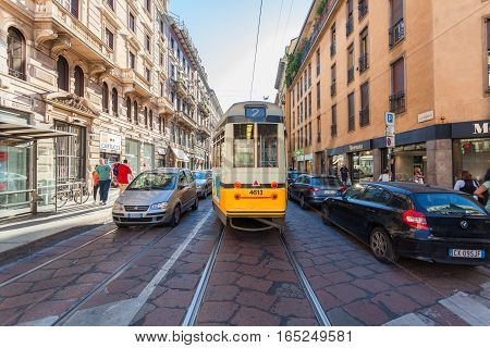 MILAN ITALY - September 06 2016: Traffic of cars and public transport on the narrow Cesare Correnti street (Via Cesare Correnti) in the city center in Milan.