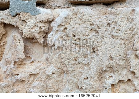 Texture background of sandstone in the sunlight